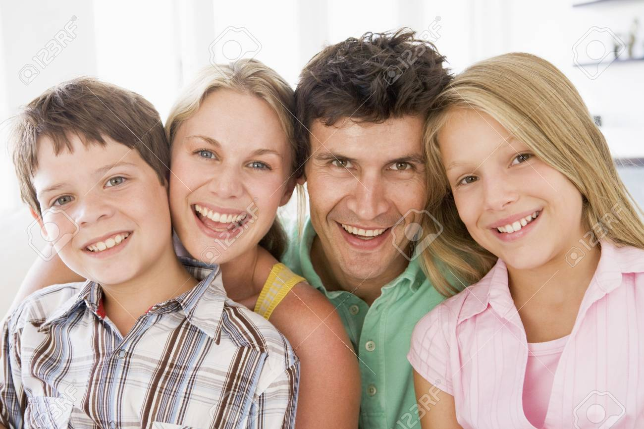 Family in living room smiling Stock Photo - 3603272
