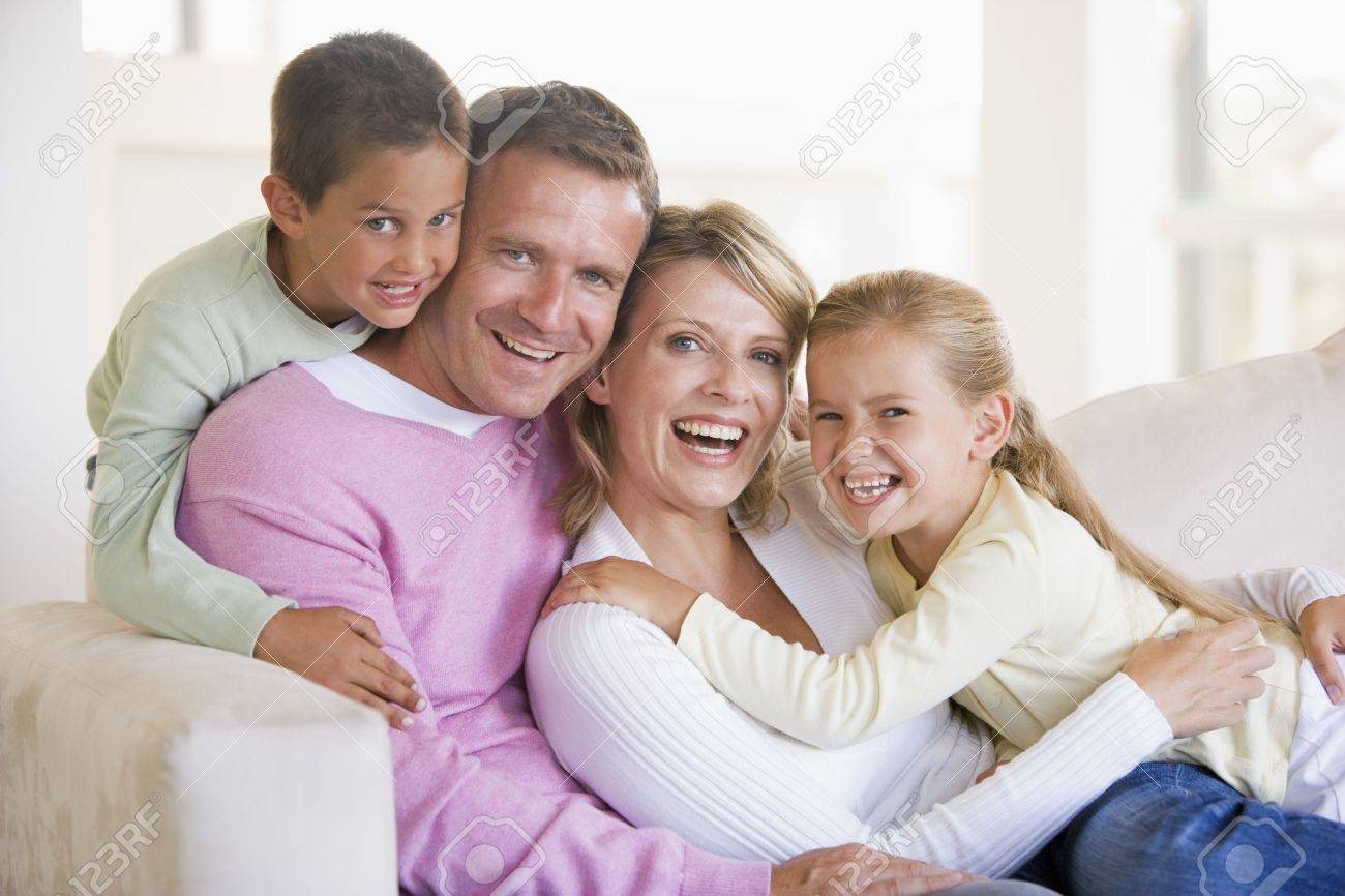 Family sitting in living room smiling Stock Photo - 3601591