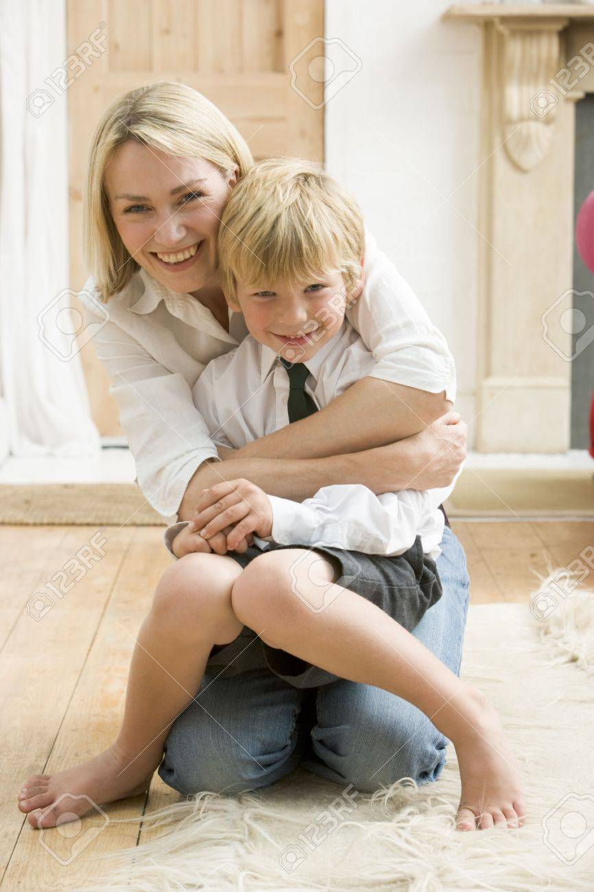 Woman in front hallway hugging young boy and smiling Stock Photo - 3601419