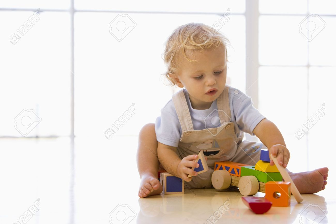 Baby indoors playing with toy truck Stock Photo - 3600555