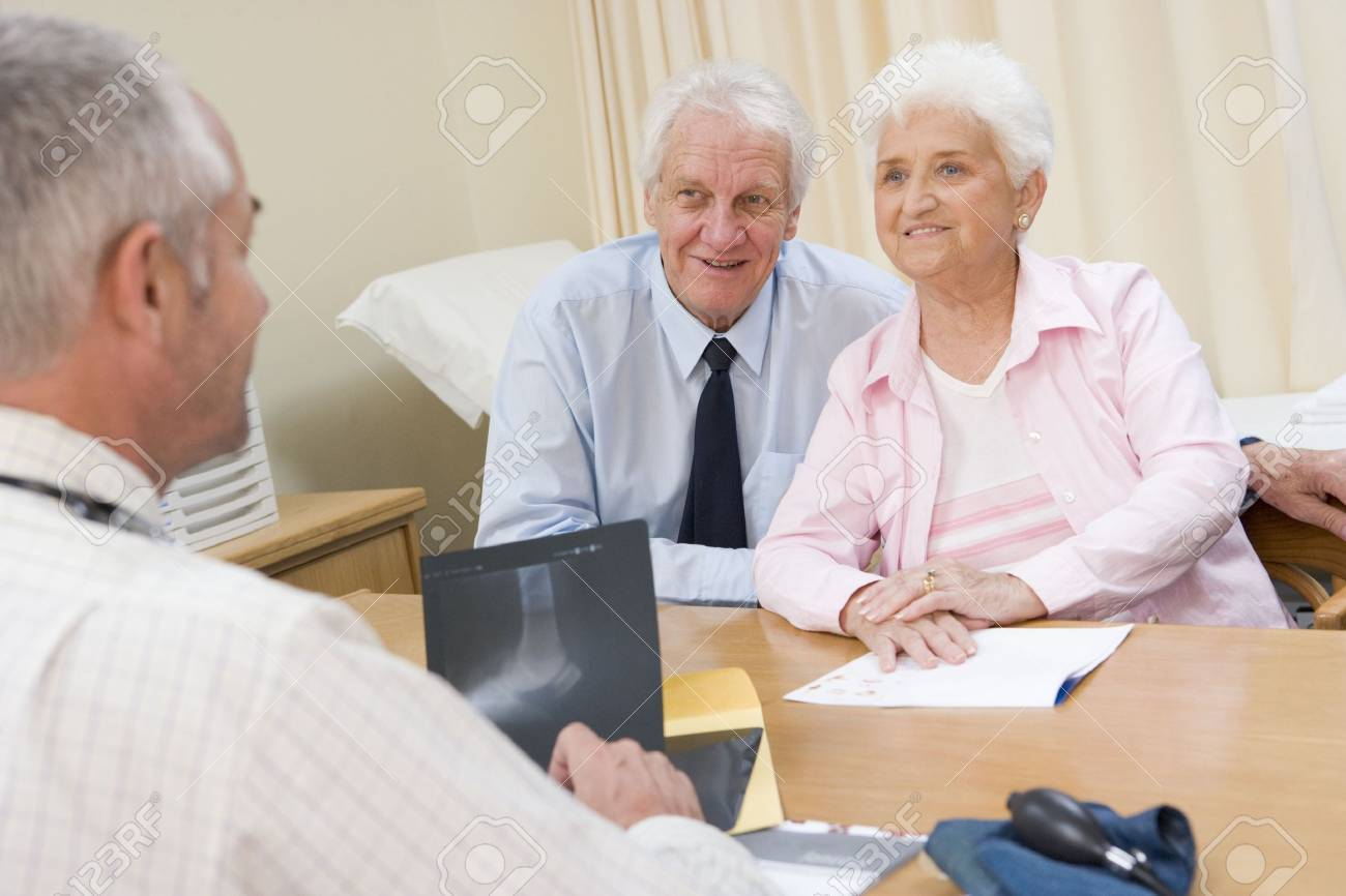 Couple in doctor's office smiling Stock Photo - 3601222