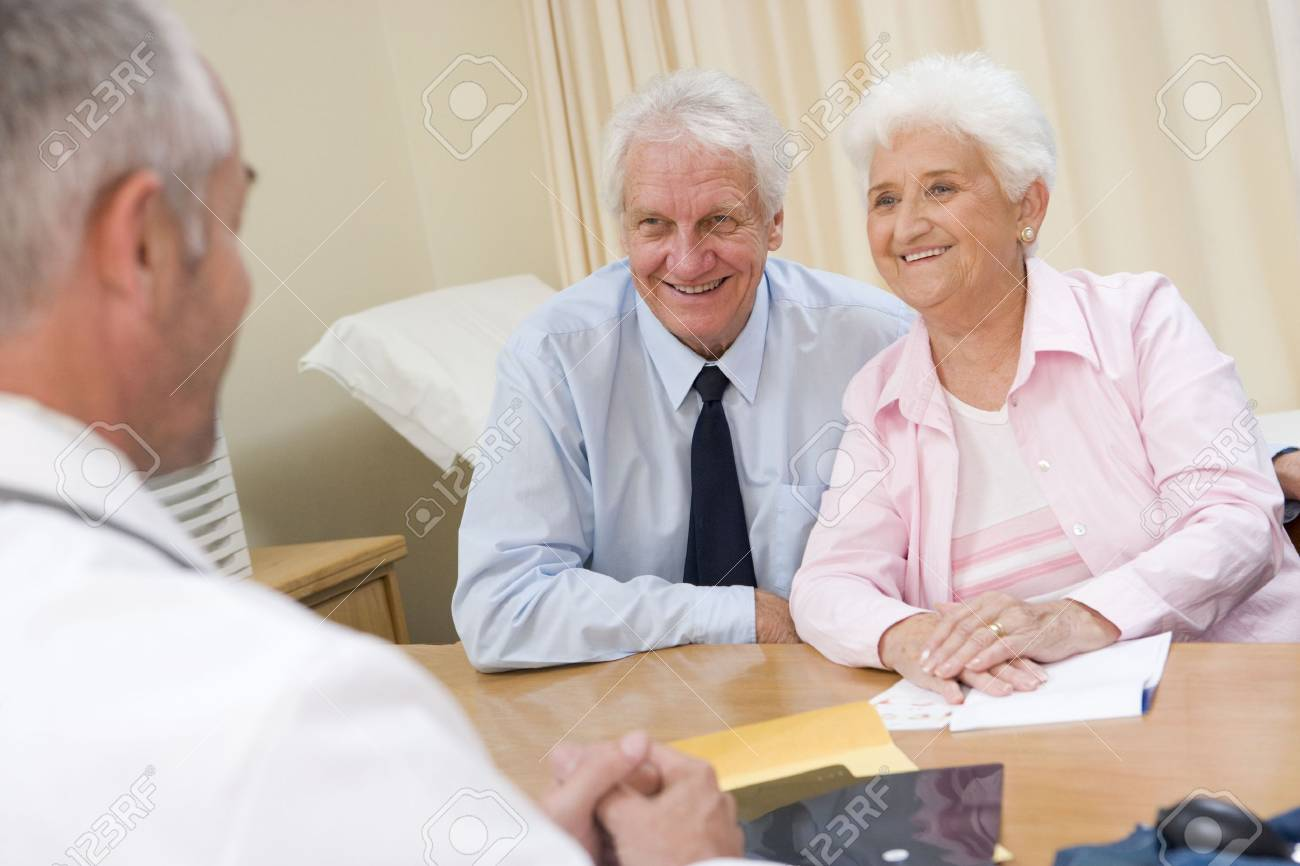 Couple in doctor's office smiling Stock Photo - 3601065