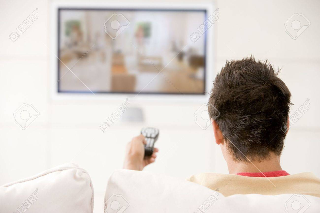 Man in living room watching television - 3482443