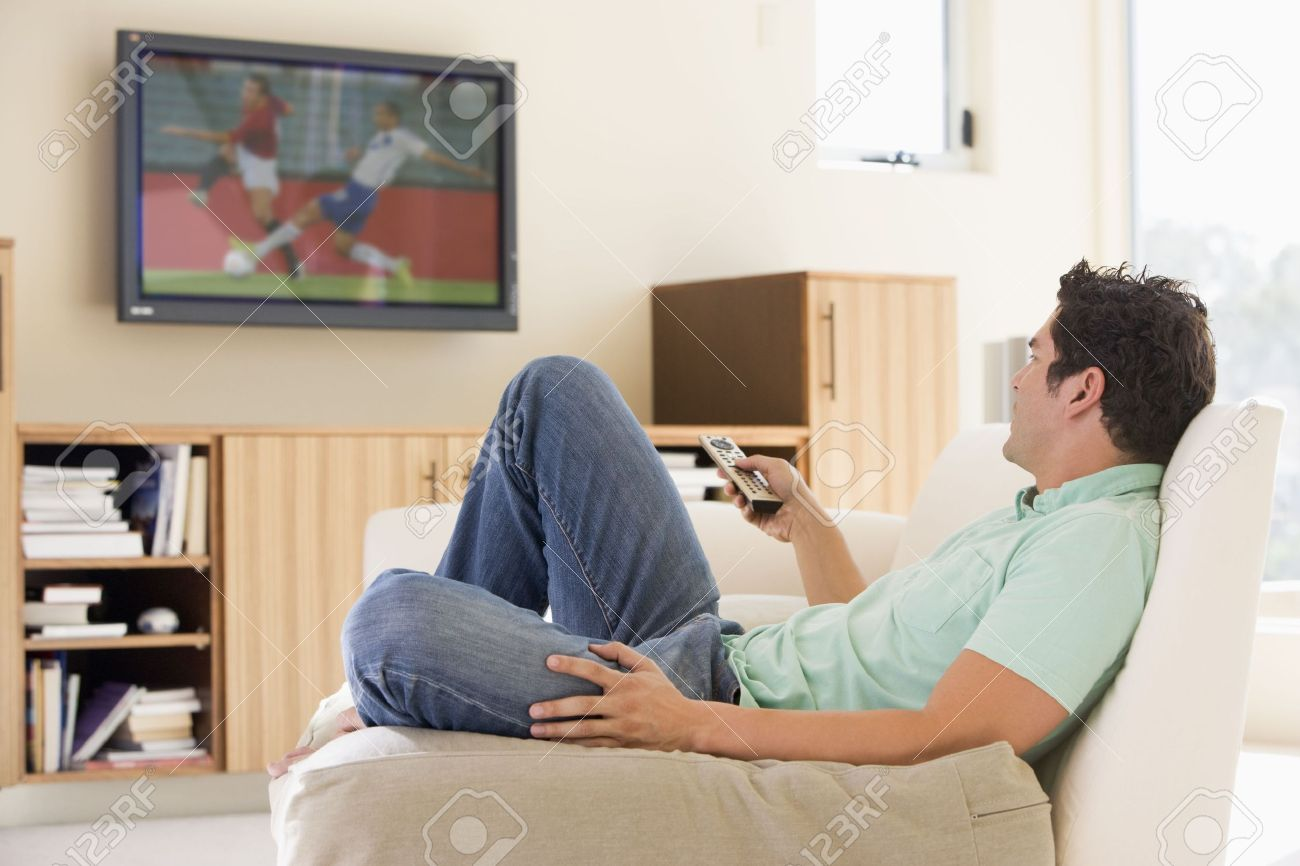 Man Living Room Man In Living Room Watching Television Stock Photo Picture And
