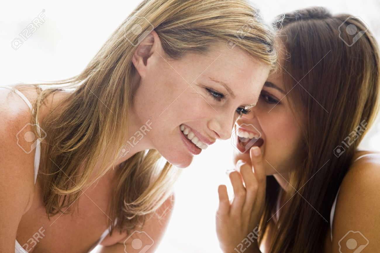 Two women whispering and smiling Stock Photo - 3485734