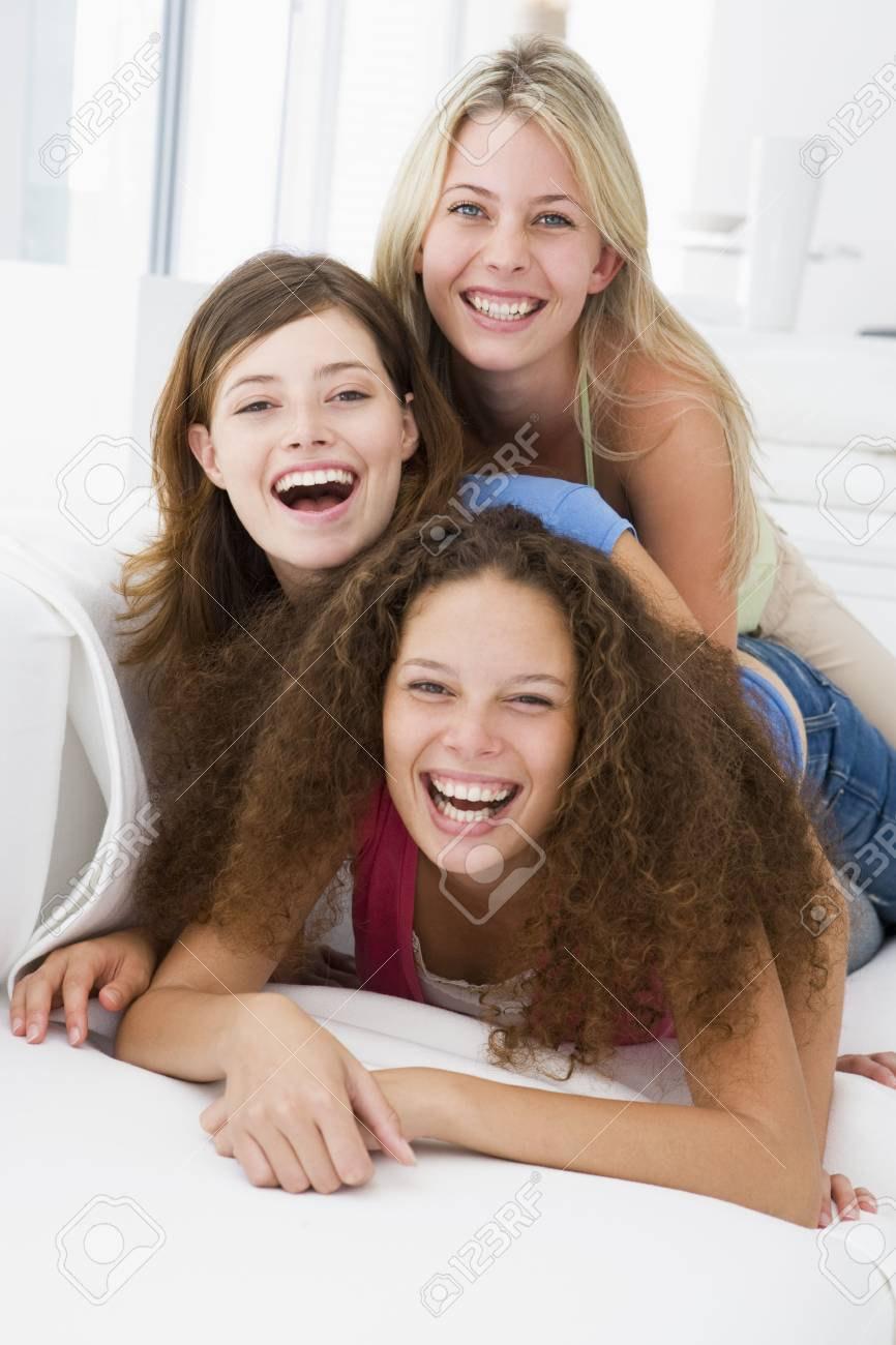 Three women in living room playing and smiling Stock Photo - 3485460