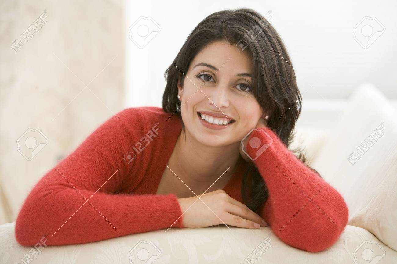 Woman sitting in living room Stock Photo - 3484728
