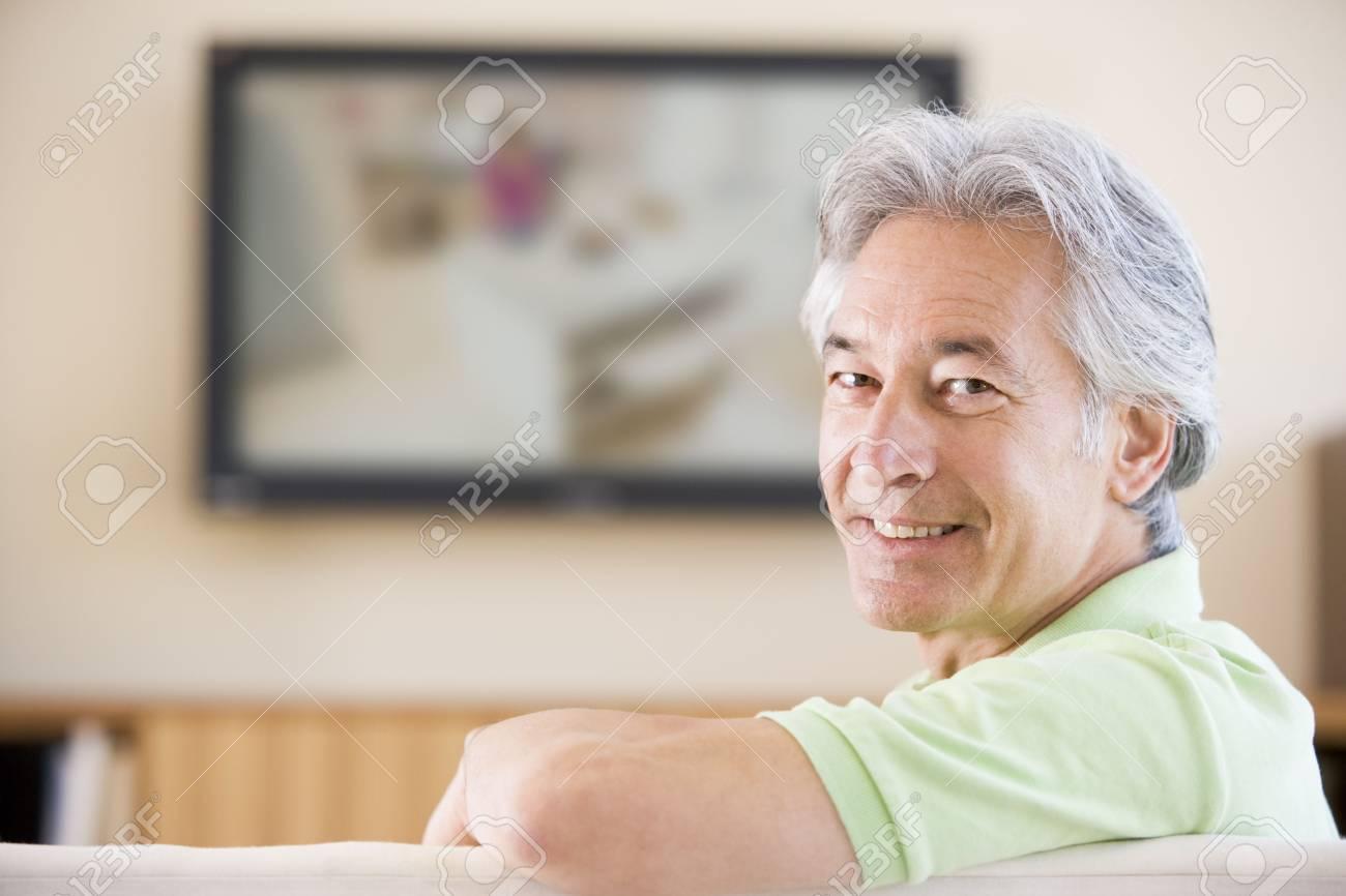 Man watching television smiling Stock Photo - 3482858