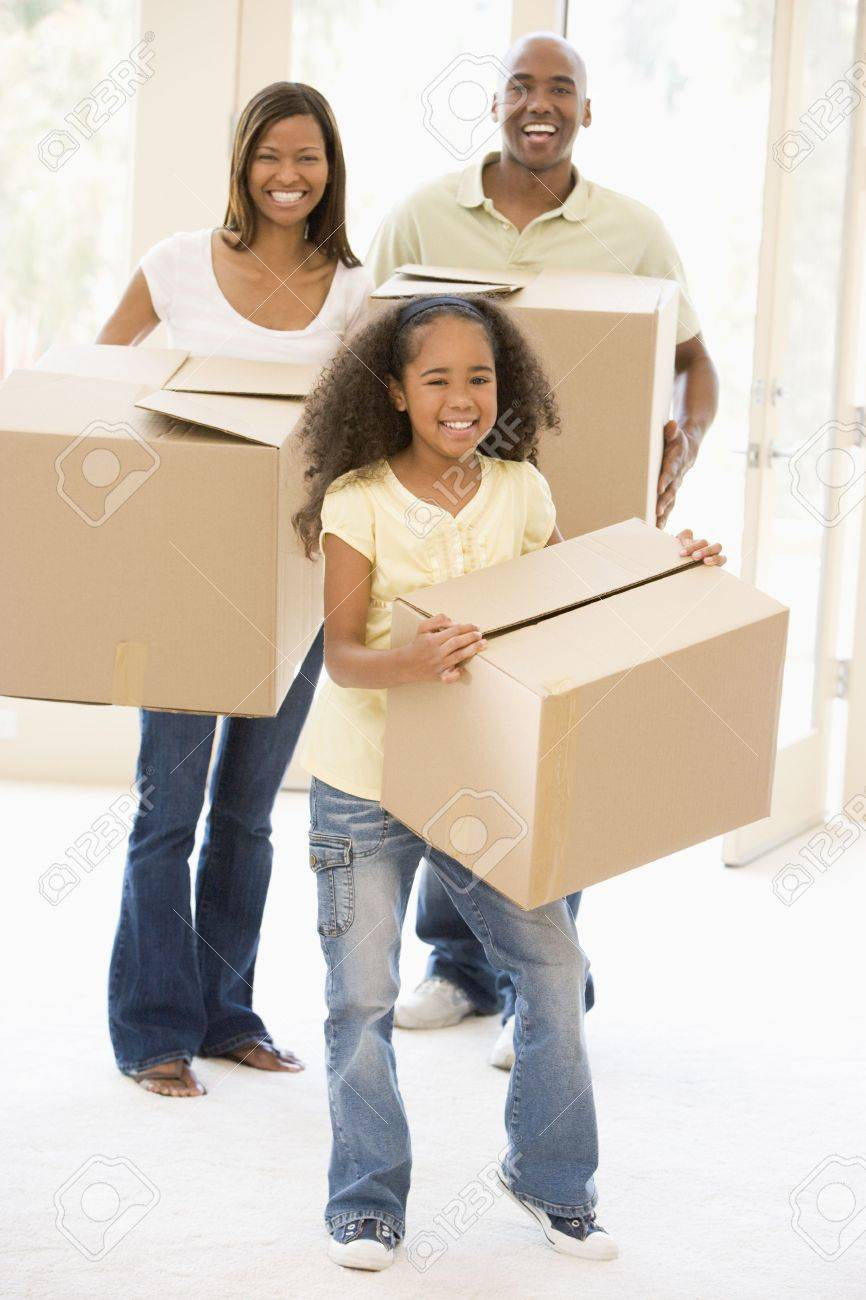 Family moving into new home smiling Stock Photo - 3486735