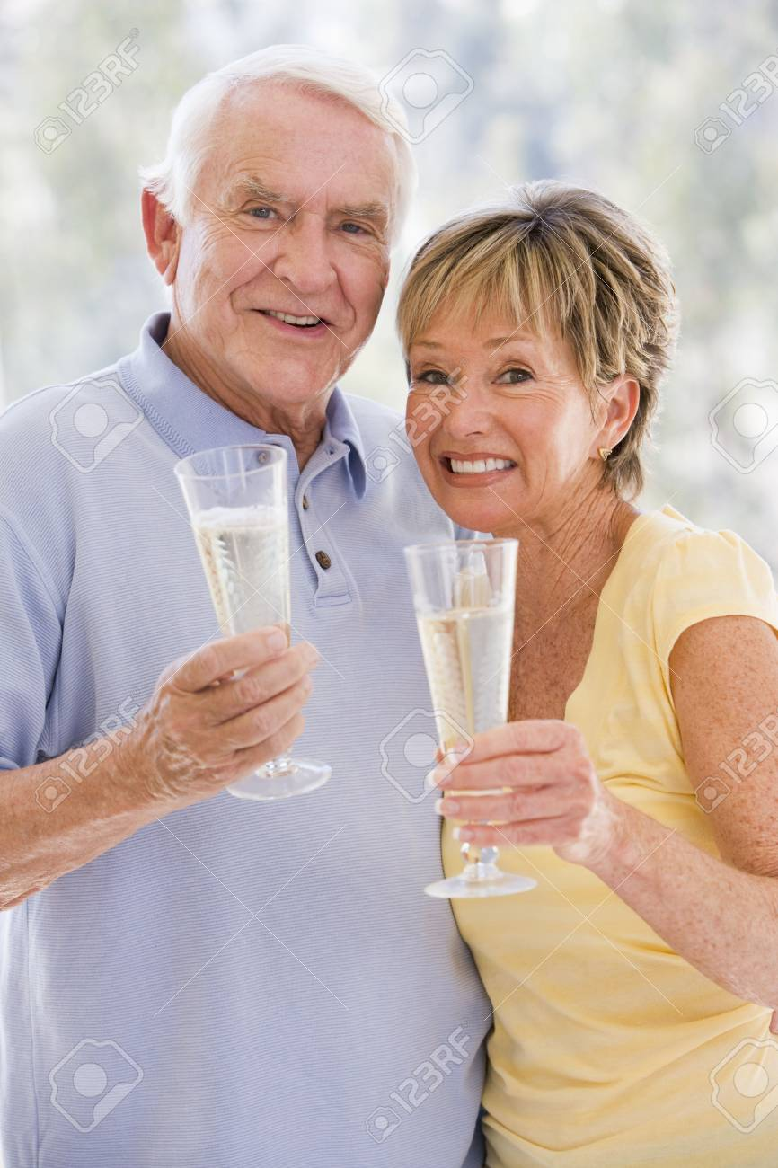 Couple toasting champagne and smiling Stock Photo - 3488166