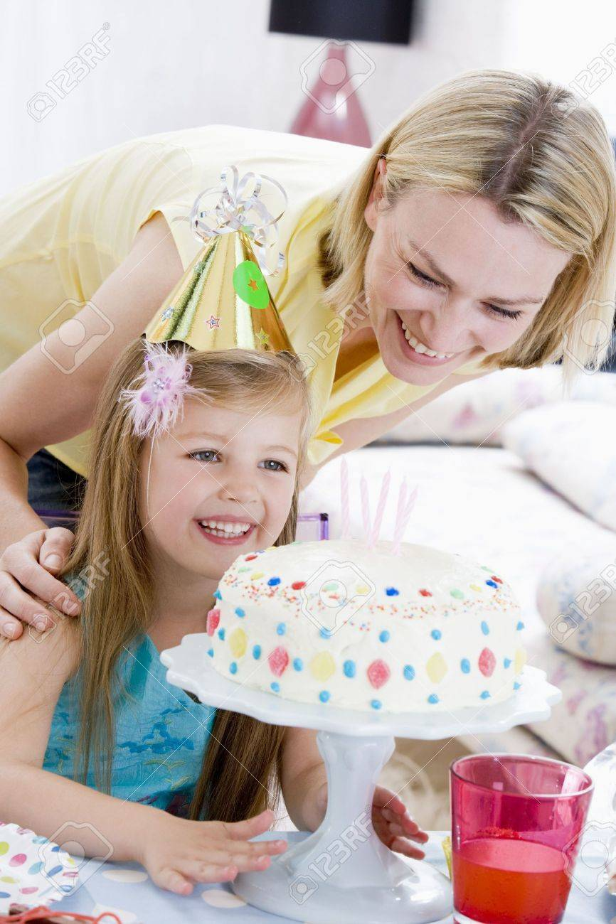 Mother and daughter with birthday cake smiling Stock Photo - 3487433