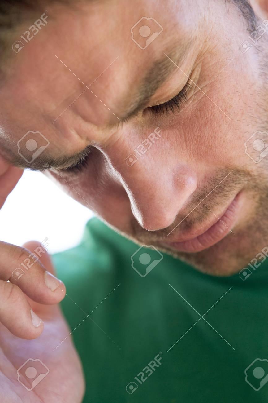 Head shot of man scowling Stock Photo - 3487133