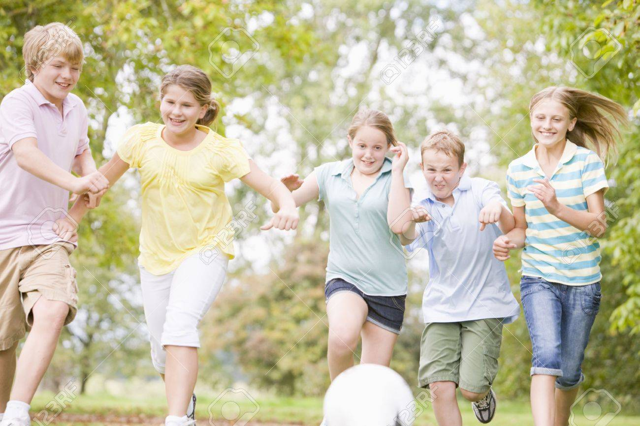 Five young friends playing soccer Stock Photo - 3487120