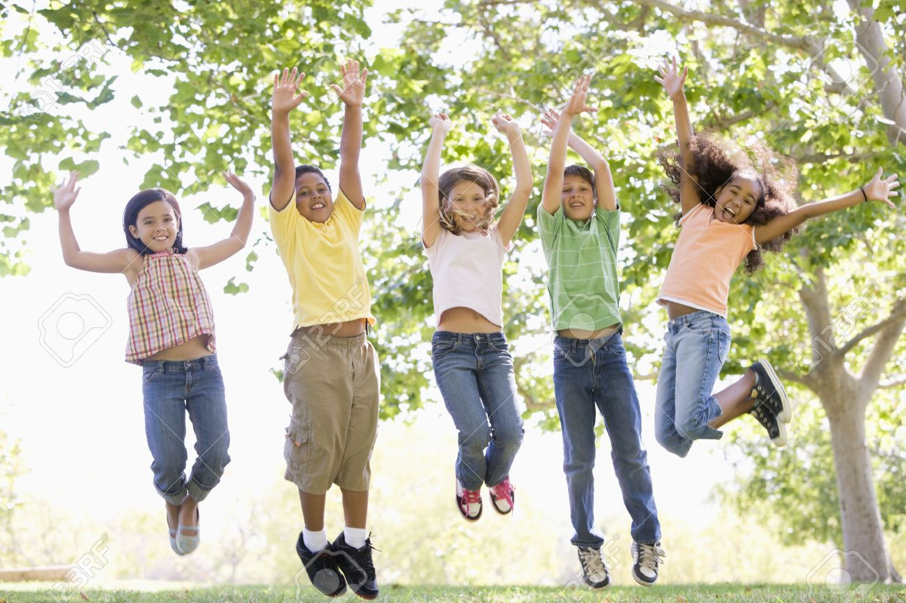 Five young friends jumping outdoors smiling Stock Photo - 3488086