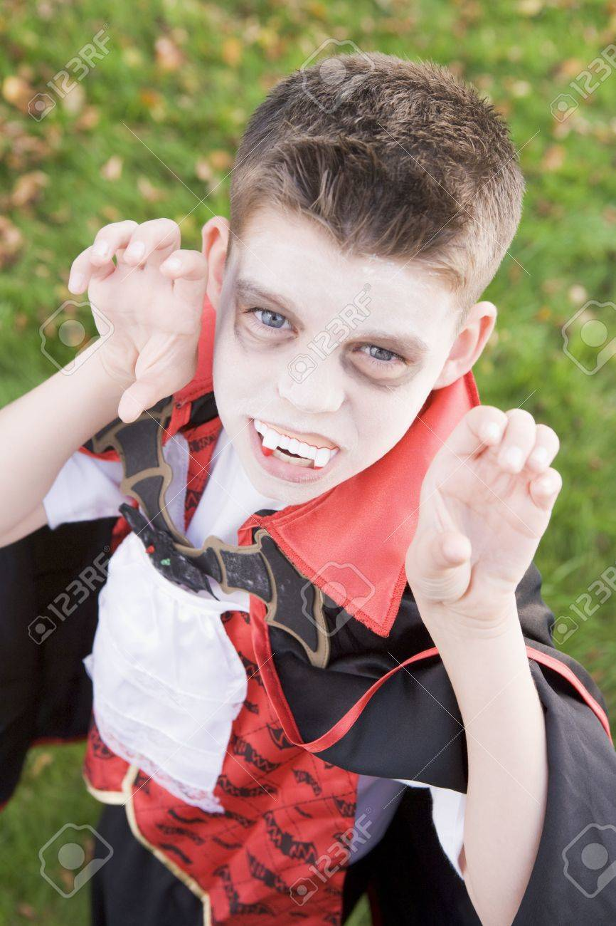 Young boy outdoors wearing vampire costume on Halloween Stock Photo - 3488083