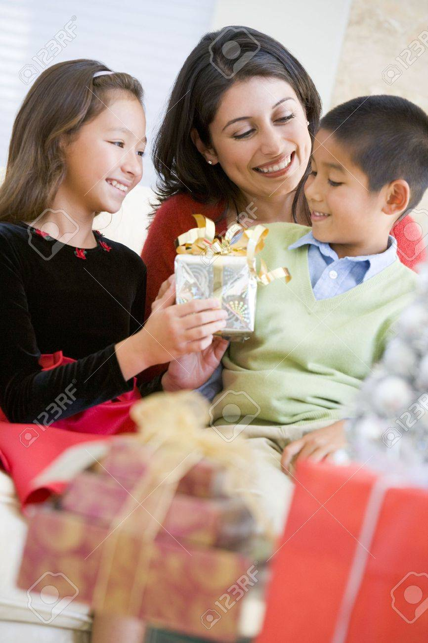 Mother Sitting With Her Son And Daughter,Exchanging Christmas Gifts Stock Photo - 3724866