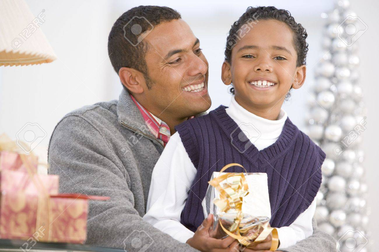 Father And Son Hugging,Holding Christmas Gift Stock Photo - 3724846