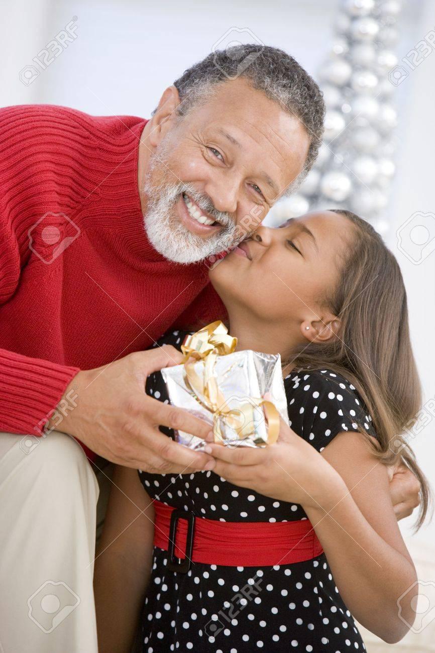 Grandfather Giving His Granddaughter A Christmas Present Stock Photo - 3724952
