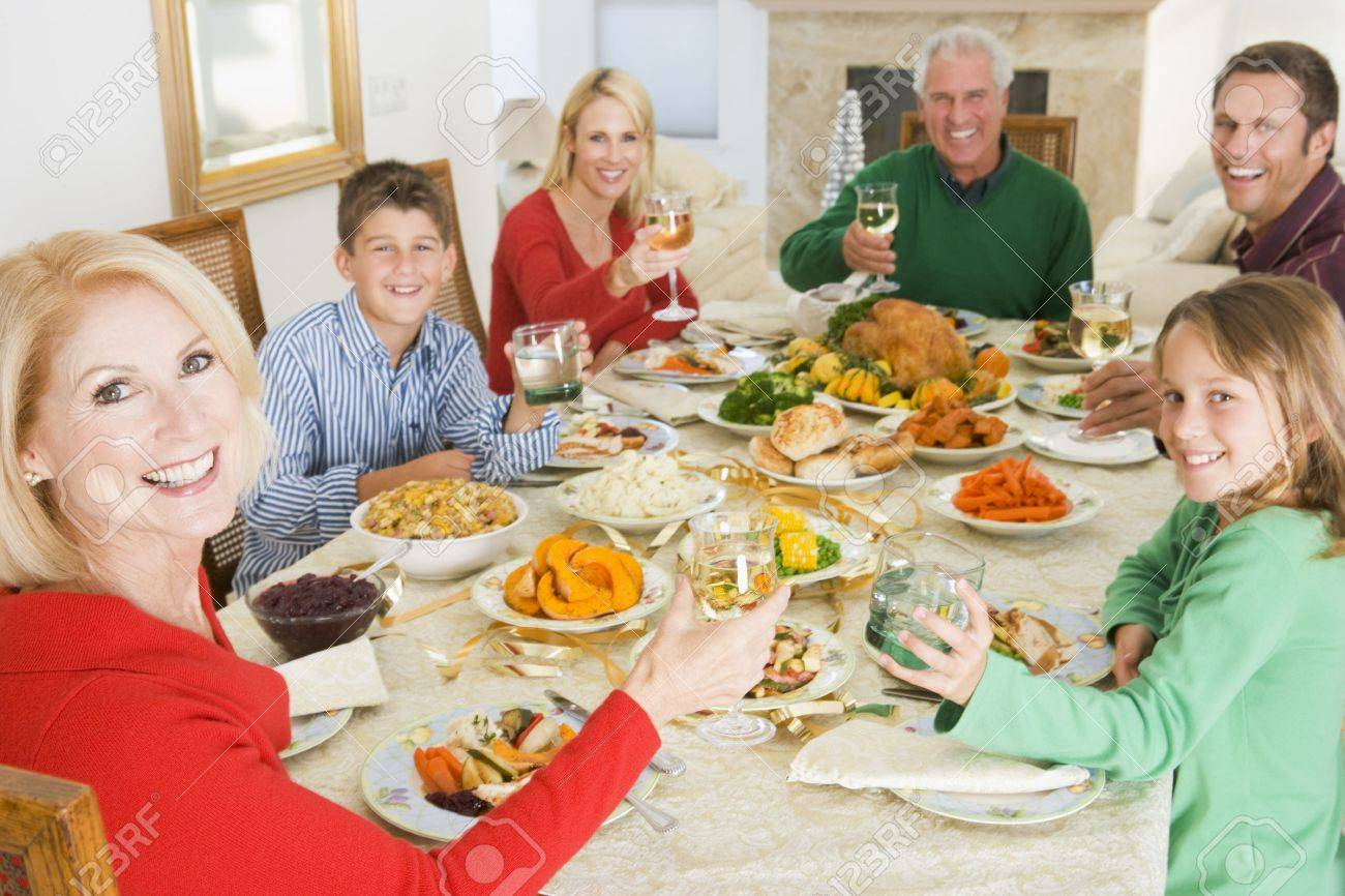 Family All Together At Christmas Dinner - 3726471