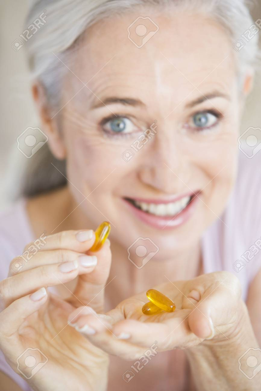 Woman Taking Pills Stock Photo - 3722933