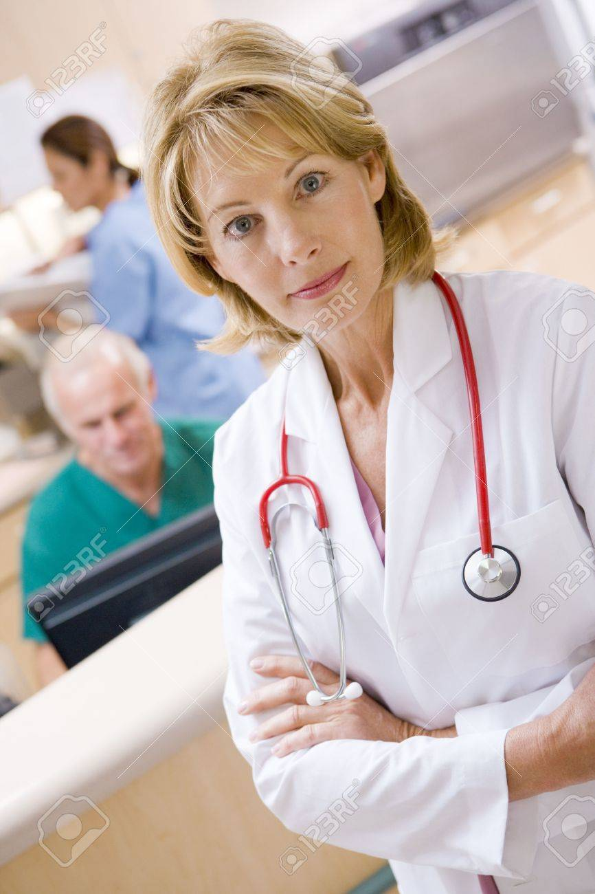 A Doctor And Nurses In The Reception Area Of A Hospital Stock Photo - 3724070