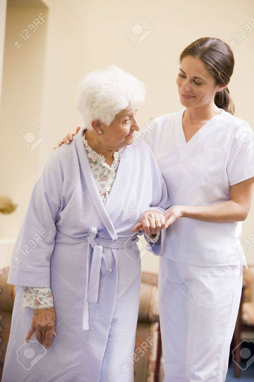 Nurse Helping Senior Woman To Walk Stock Photo - 3724294