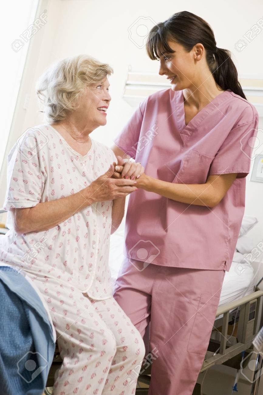 Nurse Helping Senior Woman To Walk Stock Photo - 3724325