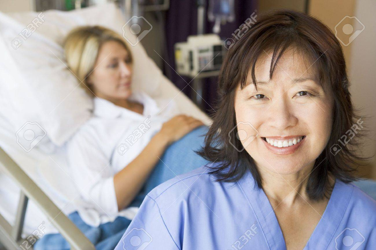 Doctor Standing In Patients Room,Smiling Stock Photo - 3724390