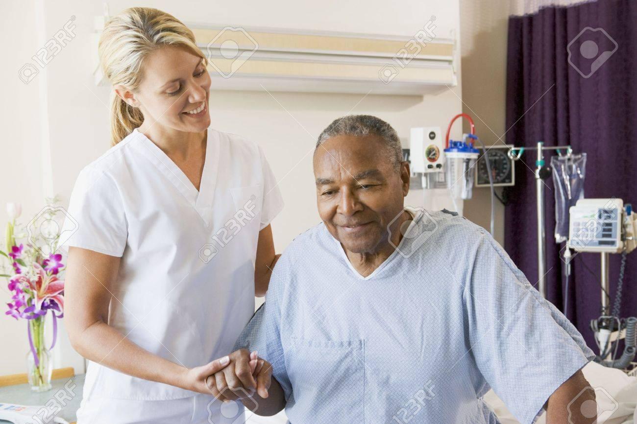 Nurse Helping Senior Man To Walk Stock Photo - 3724721
