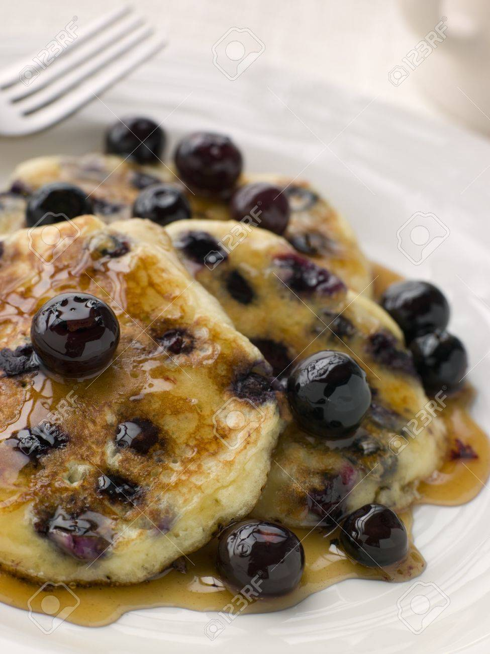 Plate Of Blueberry Pancakes With Maple Syrup Stock Photo - 4422440