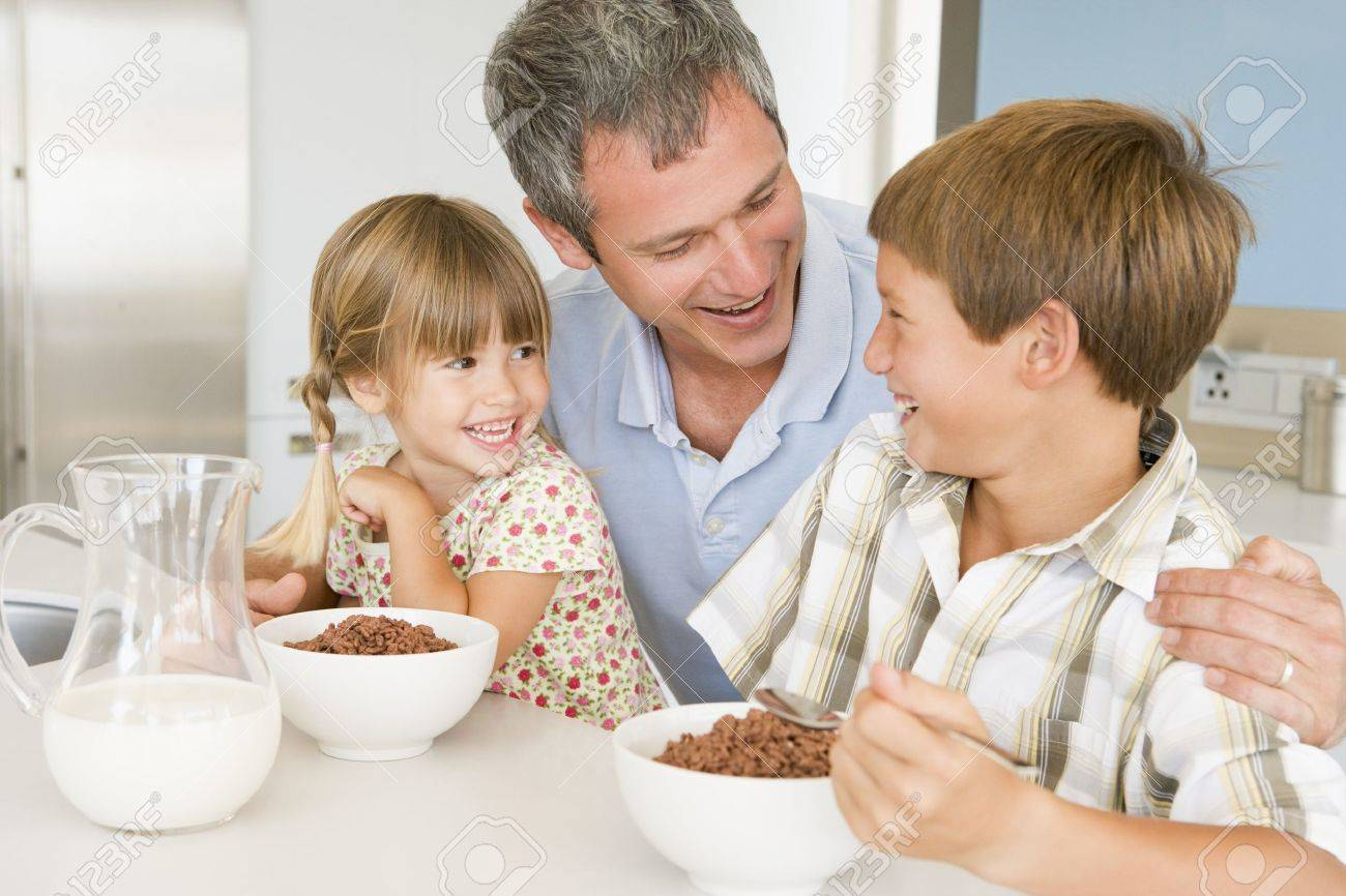 Father Sitting With Children As They Eat Breakfast Stock Photo - 4445760
