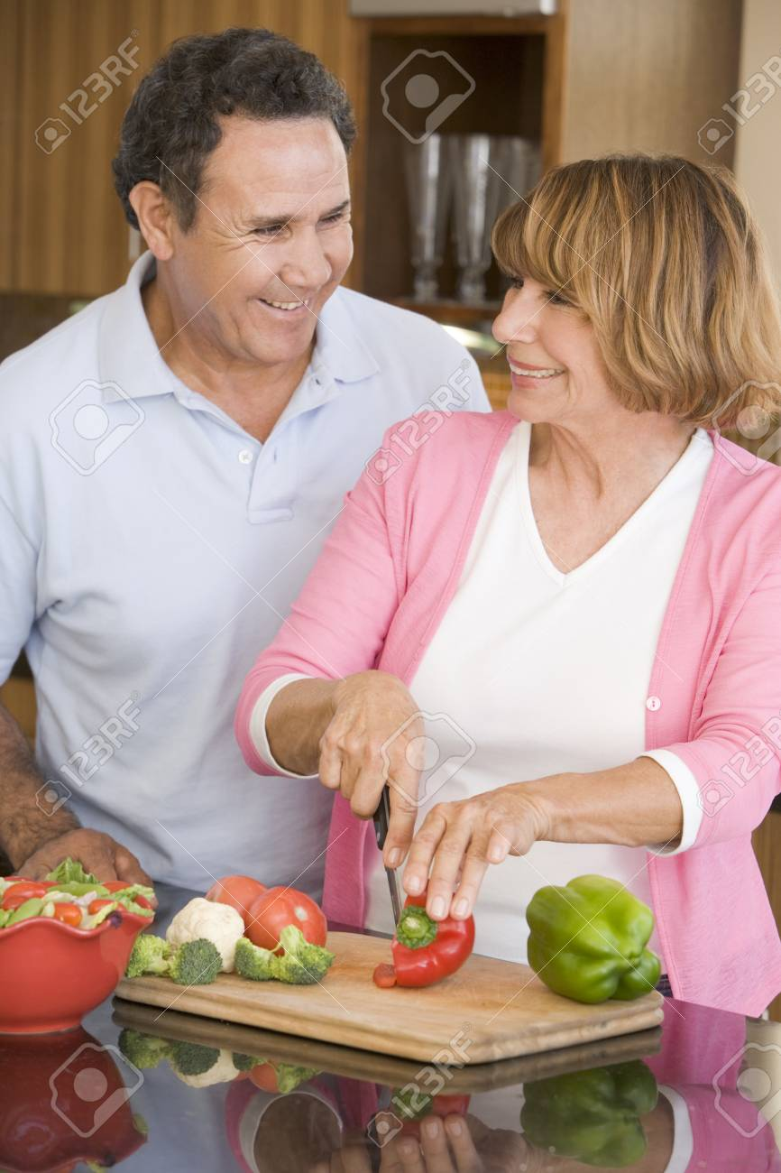 Husband And Wife Preparing meal,mealtime Together Stock Photo - 4445804