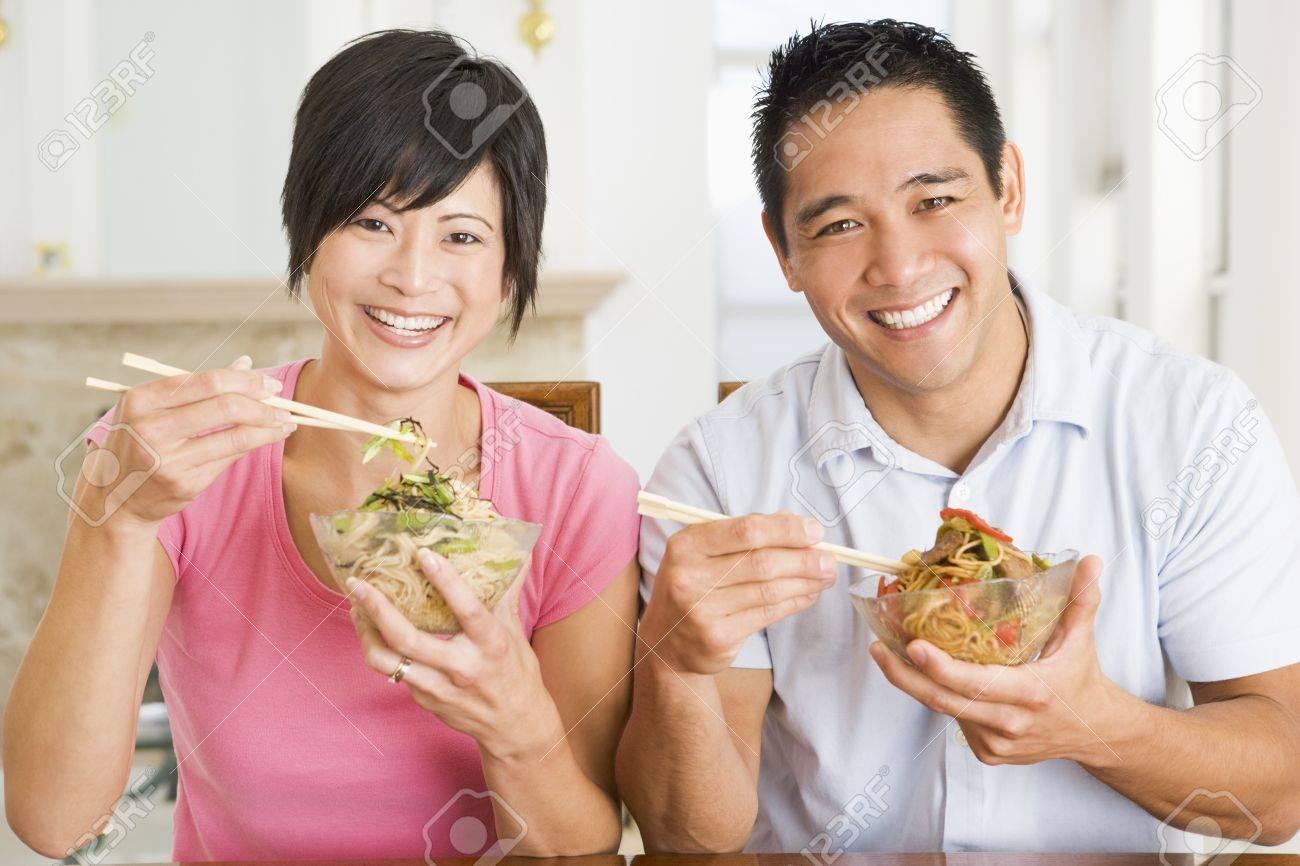 Young Couple Enjoying Chinese Food Stock Photo - 4445670