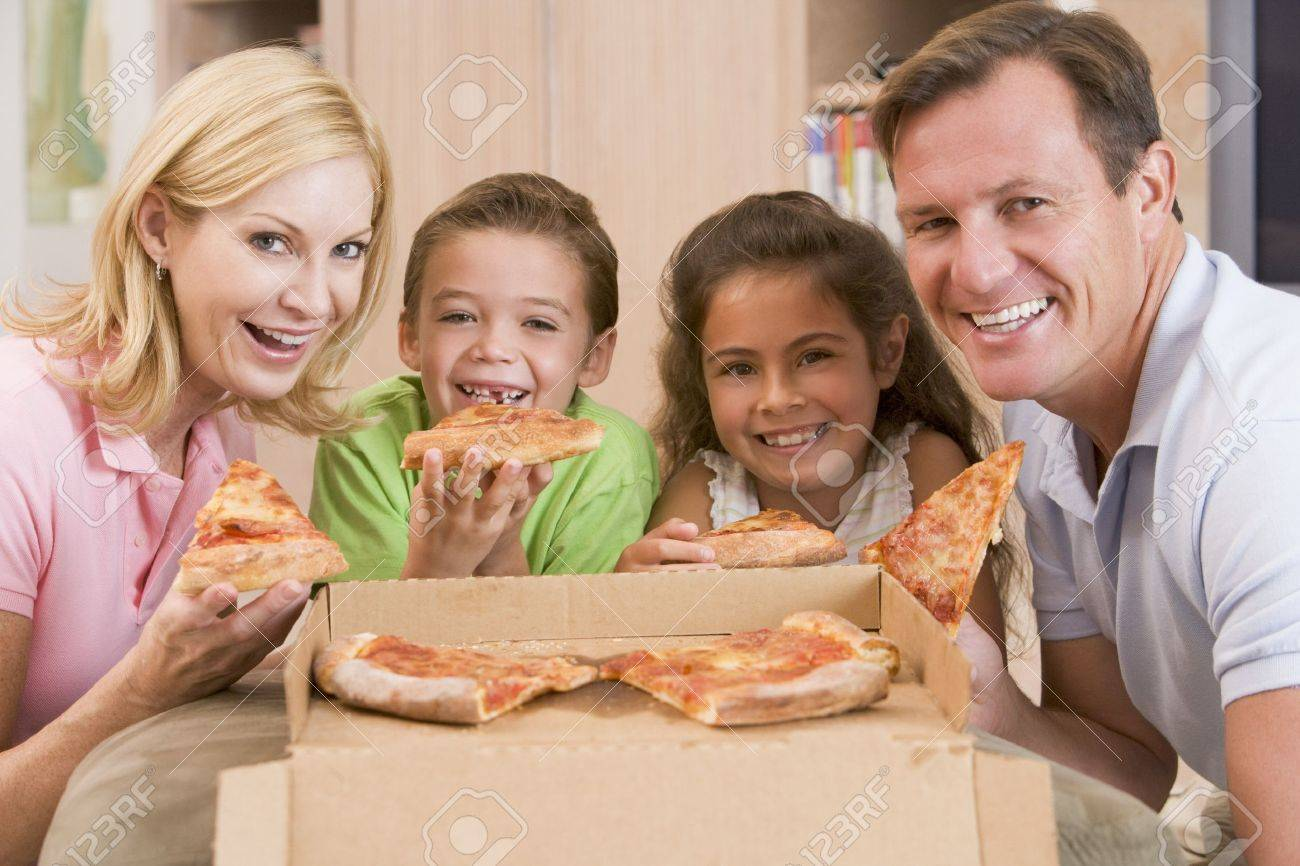 Family Eating Pizza Together Stock Photo - 4446418