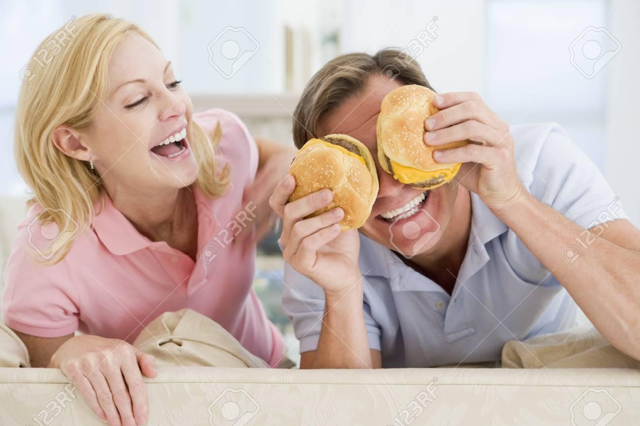 Couple Enjoying Burgers Together Stock Photo - 4445480