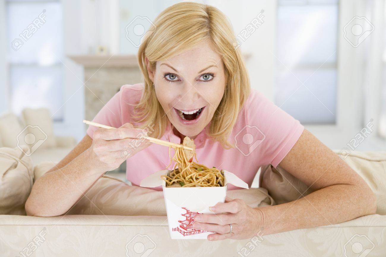 Woman Eating meal,mealtime With Chopsticks Stock Photo - 4444759