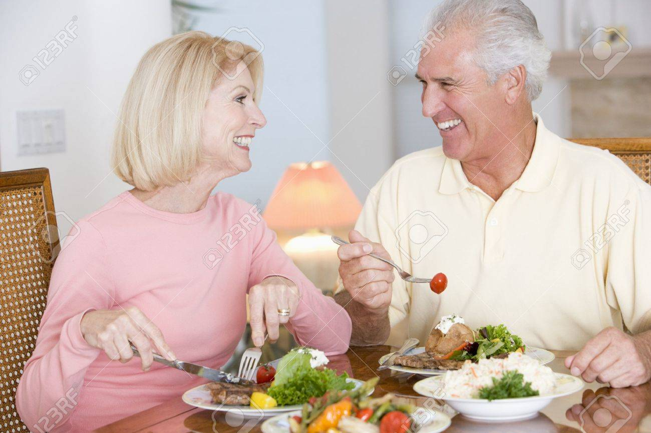 Elderly Couple Enjoying Healthy meal,mealtime Together Stock Photo - 4446172