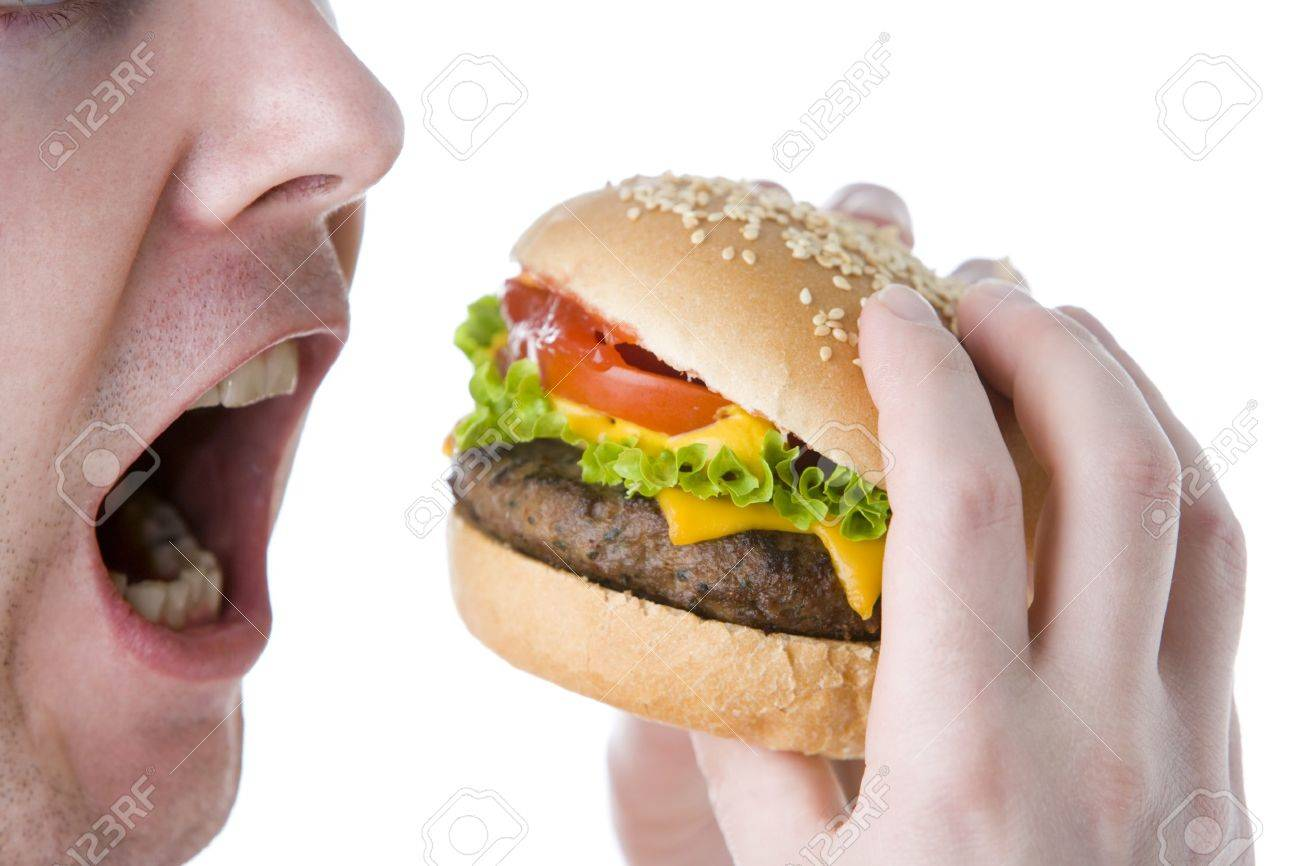 Man About To Bite Into A Cheeseburger Stock Photo - 4444557
