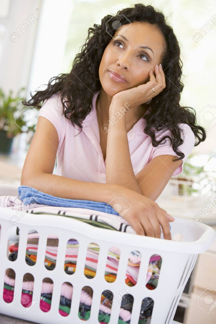 Woman Daydreaming Over Washing Basket Stock Photo - 4445263