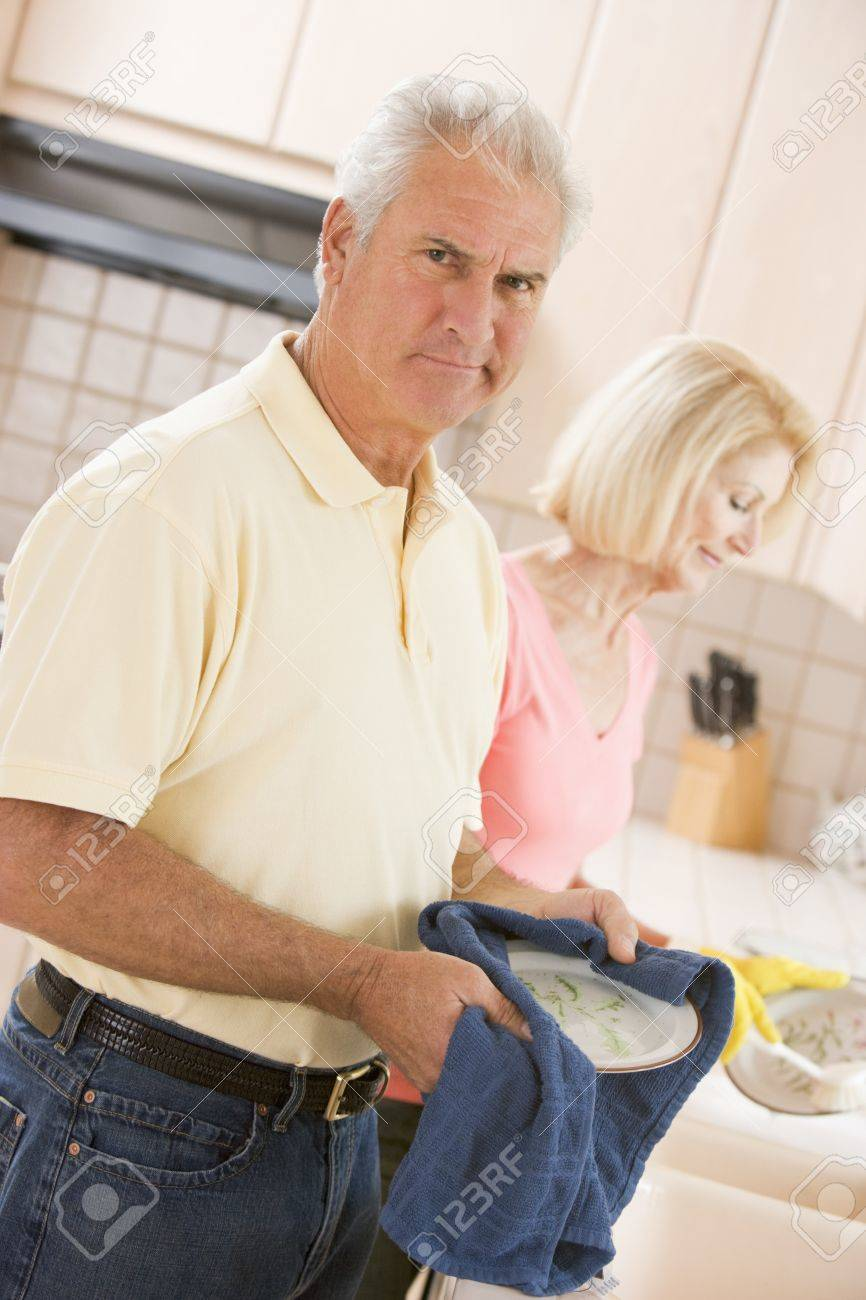 Husband And Wife Cleaning Dishes Stock Photo - 4445718