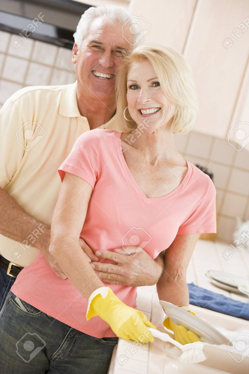 Husband And Wife Cleaning Dishes Stock Photo - 4446008