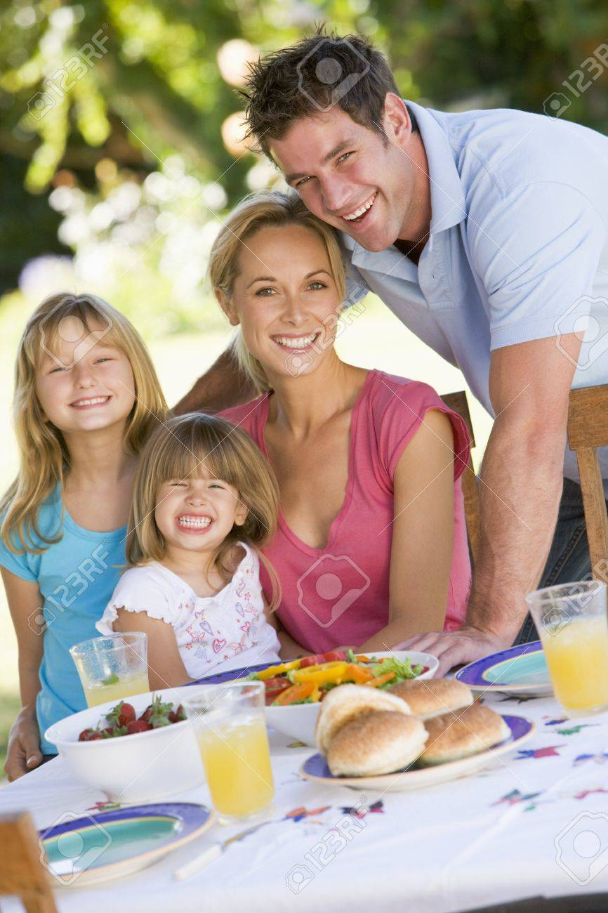 Family Enjoying A Barbeque Stock Photo - 4506977