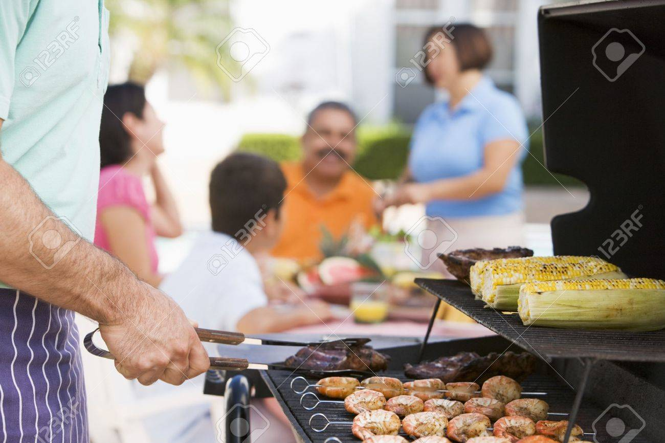 Family Enjoying A Barbeque Stock Photo, Picture And Royalty Free ...