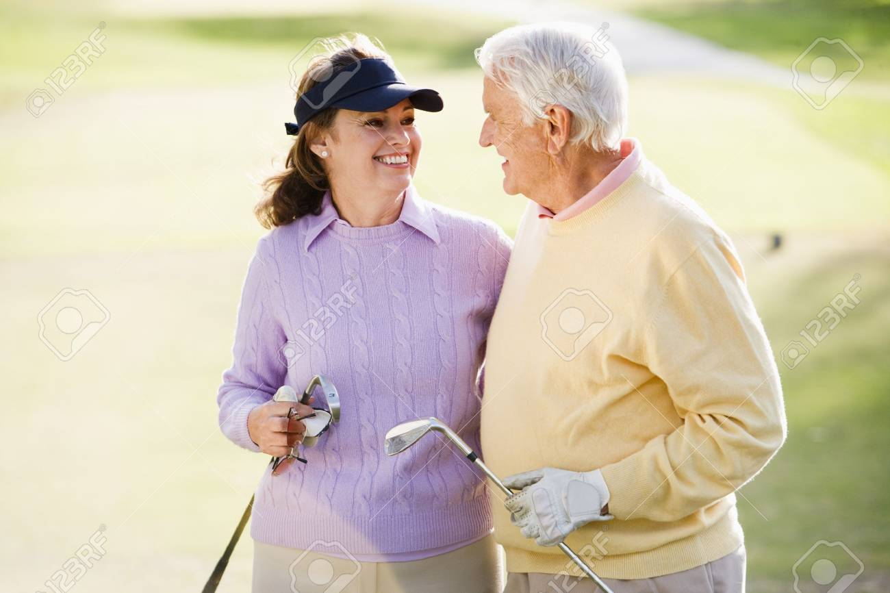 Couple Enjoying A Game Of Golf Stock Photo - 4506896