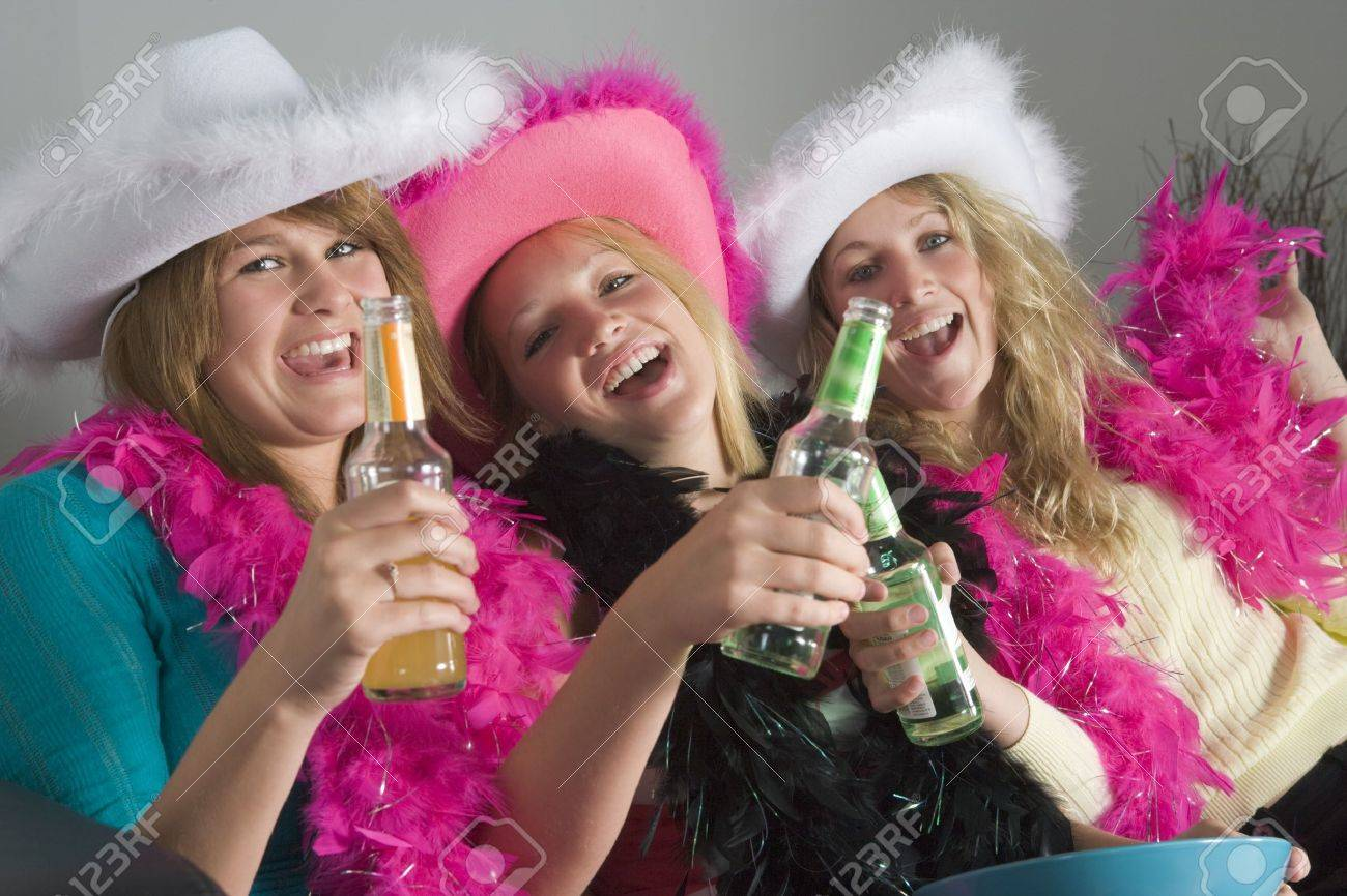 Dressed Up Teenage Girls Enjoying Drinks Stock Photo - 4507513
