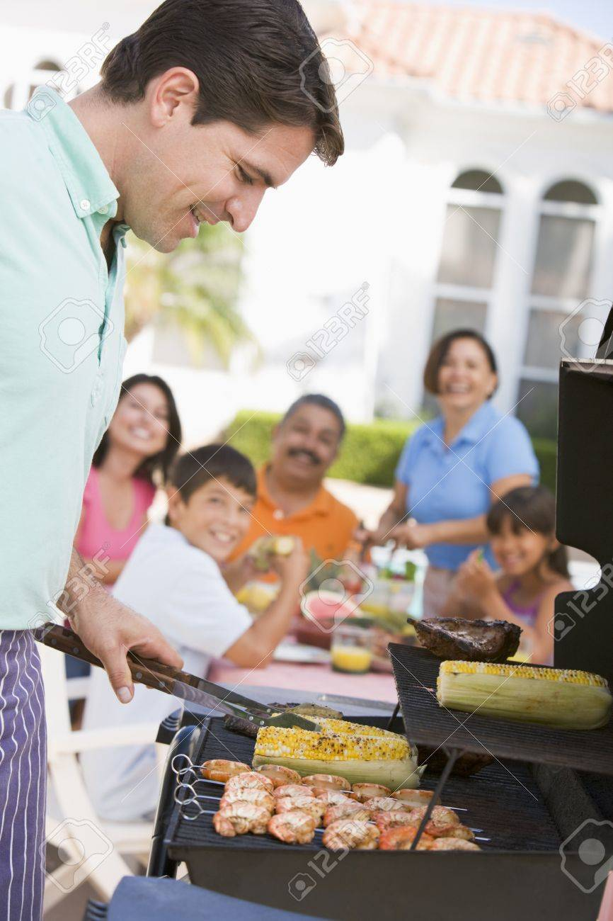 Family Enjoying A Barbeque Stock Photo - 4499037