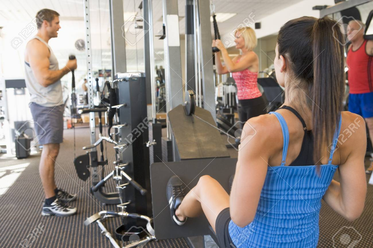 Group Of People Weight Training At Gym Stock Photo - 4499474