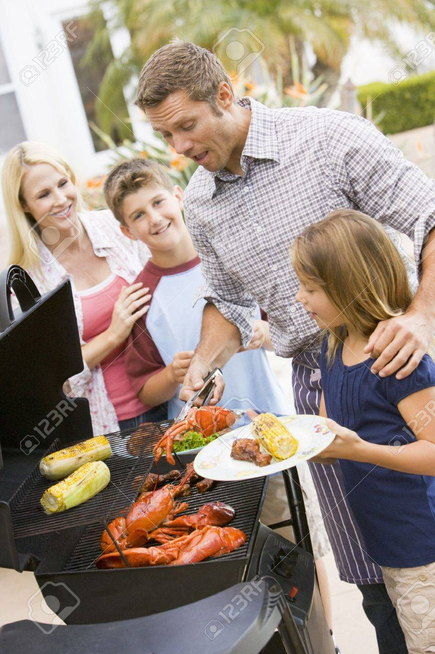 Family Enjoying A Barbeque Stock Photo - 4499841