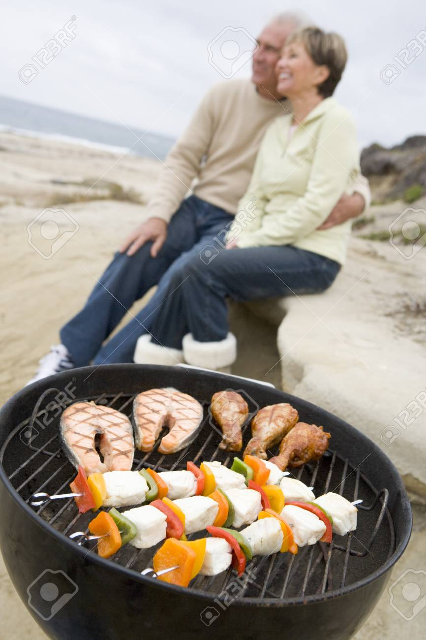 Couple Cooking On A Barbeque Stock Photo - 4499295