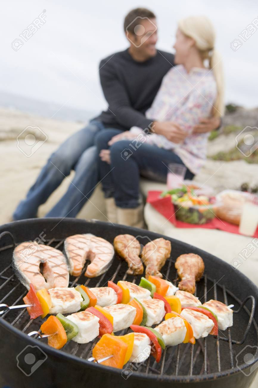 Couple Cooking On A Barbeque Stock Photo - 4499181
